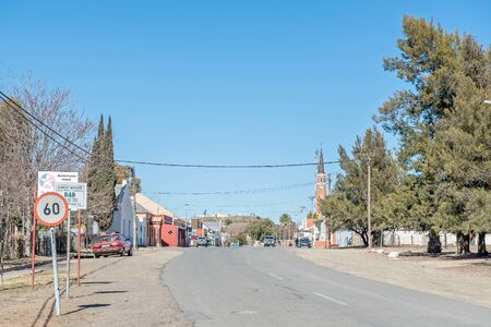northern cape: CARNAVON, SOUTH AFRICA - AUGUST 10, 2015: Street view of Carnavon in the Northern Cape Karoo region. A blockhouse from the Second Boer War is visible in the back on the hill