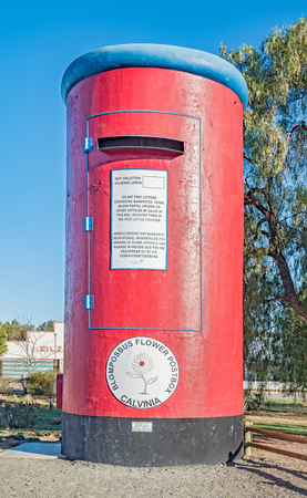 northern african: This postbox in Calvinia, South Africa, is 6 meter high and was originally an old water tower. The actial postbox can be seen attached to its left side Stock Photo