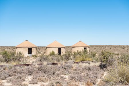 northern african: Three unoccupied railway worker rondavels next to the inoperative railway line between Carnavon and Williston in the Northern Cape Karoo region of South Africa