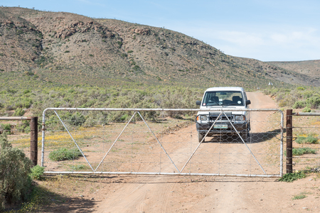 south africa soil: NARESIE, SOUTH AFRICA - AUGUST 11, 2015: A farm gate on the road between Naresie and Gannabos. This scenic route is usually abundant with wild flowers during August and early September Editorial