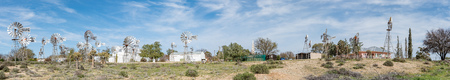 northern cape: LOERIESFONTEIN, SOUTH AFRICA - AUGUST 11, 2015: Panorama of the Windmill museum next to the Fred Turner Museum in Loeriefontein in the Namaqualand region of the Northern Cape Province