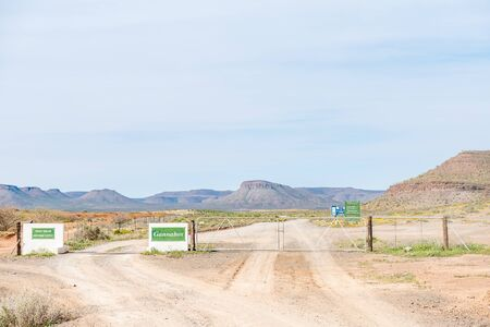 cattle grid: GANNABOS, SOUTH AFRICA - AUGUST 11, 2015: A typical sight on rural roads in South Africa - a gate for heavy vehicles which is closed permanently and a cattle grid for smaller vehicles.