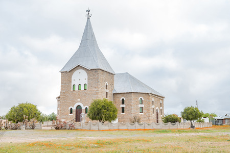 bible flower: The Dutch Reformed Church in Kamieskroon in the Namaqualand Region of South Africa was built from granite and completed in 1924 Stock Photo
