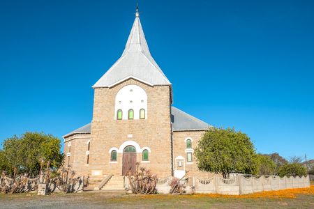 northern african: The Dutch Reformed Church in Kamieskroon  in the Namaqualand Region of South Africa was built with granite and completed in 1924