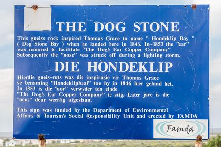 northern african: HONDEKLIPBAAI, SOUTH AFRICA - AUGUST 14, 2015: Sign board in Hondklipbaai dog stone bay on the South African Atlantic coast