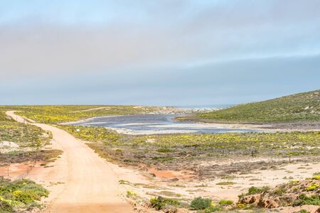 northern african: The Groenrivier green river near to its mouth at the Northern Cape Atlantic coast. The South African Parks Board offices are visible in the back Stock Photo