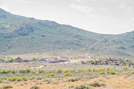 springbok: SPRINGBOK, SOUTH AFRICA - AUGUST 17, 2015: The offices of the Goegap Nature Reserve with the Hester Malan Succulent Garden next to it. One of the 4x4 routes are visible in the back
