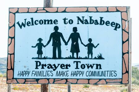 northern african: NABABEEP, SOUTH AFRICA - AUGUST 17, 2015: A welcome sign board in Nababeep, a small mining town in the Northern Cape Namaqualand