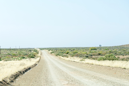 south africa soil: Typical Karoo gravel road in the Northern Cape Karoo region of South Africa