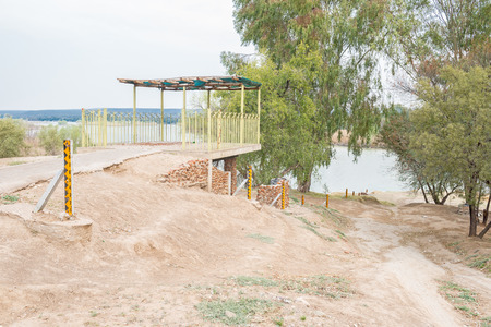 confluence: Viewpoint with water level markers at the confluence of the Gariep Orange and Vaal Rivers near Douglas in the Northern Cape Province of South Africa
