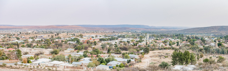 township: PRIESKA, SOUTH AFRICA - AUGUST 24, 2015: Sunrise panorama of Prieska in the Northern Cape Province of South Africa. The Gariep River is visible in the back