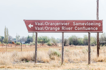 northern african: DOUGLAS, SOUTH AFRICA - AUGUST 25, 2015: Road sign pointing to the confluence of the Gariep Orange and Vaal Rivers near Douglas in the Northern Cape Province of South Africa.