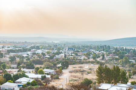 northern cape: PRIESKA, SOUTH AFRICA - AUGUST 24, 2015: A hazy and dusty view of Prieska in the Northern Cape Province of South Africa. The Gariep River is in the back