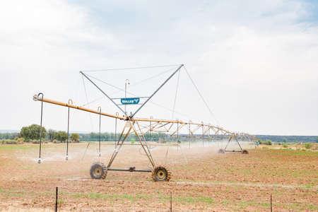 pivot: DOUGLAS, SOUTH AFRICA - AUGUST 25, 2015: A center pivot irrigation system using rotator style pivot applicator sprinklers near Douglas in the Northern Cape Province