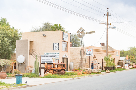 gaol: VANRHYNSDORP, SOUTH AFRICA - AUGUST 12, 2015: A coffee shop and the old jail in Vanrhynsdorp, a small town in the Western Cape Province