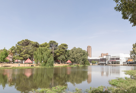 december 21: BLOEMFONTEIN, SOUTH AFRICA, DECEMBER 21, 2015: Part of the Loch Logan Waterfront with picnic places on Loch Logan Island to the left