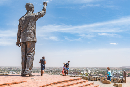 mandela: BLOEMFONTEIN, SOUTH AFRICA, DECEMBER 21, 2015: The 6.5m bronze statue of Nelson Mandela on Naval hill in Bloemfontein. Waaihoek, where the ANC was founded, is next to the cooling towers in the back