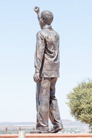 BLOEMFONTEIN, SOUTH AFRICA, JANUARY 6, 2016: The 6.5m bronze statue of Nelson Mandela on Naval hill guarding over Bloemfontein Editorial