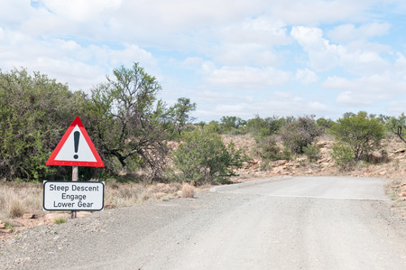 descend: A steep descend warning on the link road in the Mountain Zebra National Park near Cradock in South Africa