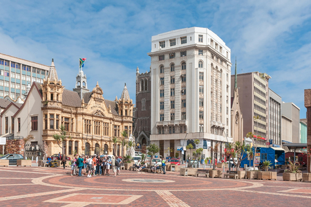 PORT ELIZABETH, SOUTH AFRICA - FEBRUARY 27, 2016: Unidentified tourists at the historic Market Square in Port Elizabeth. Several historic buildings are visible Editöryel