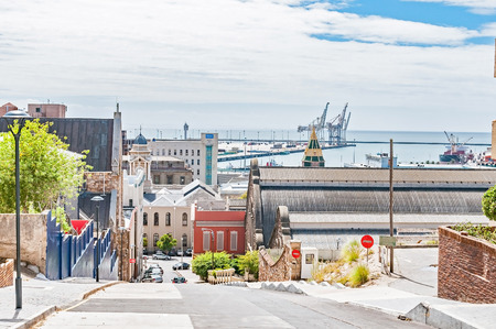 PORT ELIZABETH, SOUTH AFRICA - FEBRUARY 27, 2016: A street view of Port Elizabeth, which includes the original Feather Market building and the harbor Editorial