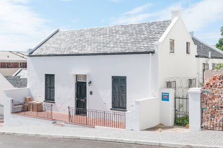 settler: PORT ELIZABETH, SOUTH AFRICA - FEBRUARY 27, 2016: A typical Settler cottage in Georgian architectural style dating from about 1840. A declared national monument