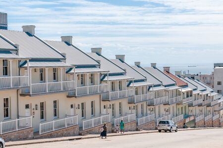 PORT ELIZABETH, SOUTH AFRICA - FEBRUARY 27, 2016: Historic double-storeyed semi-detached houses with Victorian and Georgian features, erected during early 20th century