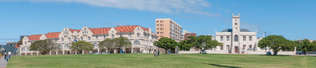 king edward: PORT ELIZABETH, SOUTH AFRICA - FEBRUARY 27, 2016: The historic King Edward Hotel, built in 1903, and the historic Old Grey Institute, built in 1858. The clock tower was added in 1875