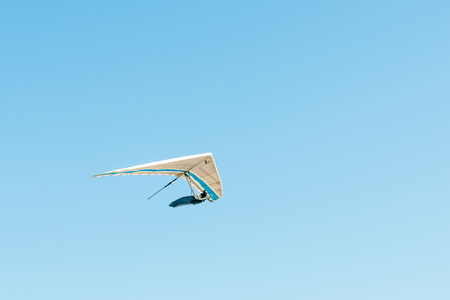 hang glider: PORT ELIZABETH, SOUTH AFRICA - FEBRUARY 27, 2016:  A hang glider in the air at Beachview near Port Elizabeth