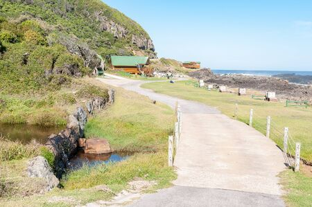 chalets: STORMS RIVER MOUTH, SOUTH AFRICA - FEBRUARY 28, 2016:  A mountain stream, camping sites and chalets at the rest camp at Storms River Mouth