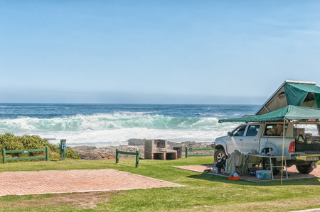 nature conservancy: STORMS RIVER MOUTH, SOUTH AFRICA - FEBRUARY 29, 2016:  A pick-up truck with roof ten and a sea view in a typical view at the rest camp at Storms River Mouth