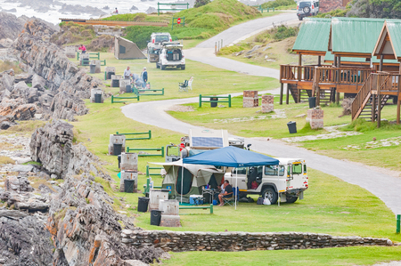 chalets: STORMS RIVER MOUTH, SOUTH AFRICA - MARCH 1, 2016:  Unidentified tourists at camping sites next to chalets at Storms River Mouth