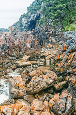 return trip: The rugged terrain of the Waterfall Trail at Guano Cave on an overcast day, a difficult 6.4 km return trip which follows part of the renowned Otter trail