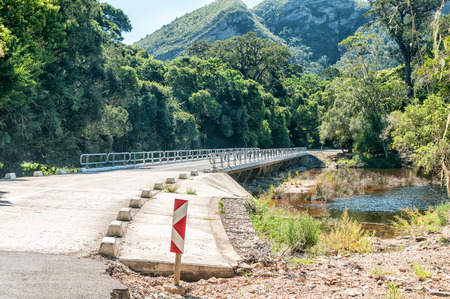 Bridge over the Groot River at the bottom of the Grootrivier Pass passing through the Tsitsikama Forest