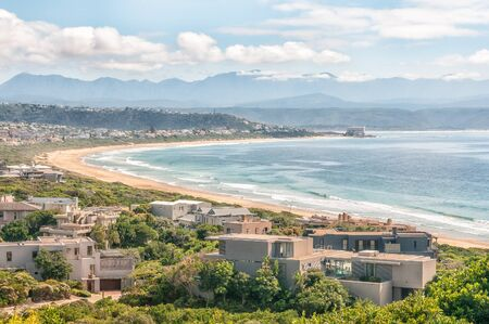 PLETTENBERG BAY, SOUTH AFRICA - MARCH 3, 2016: View from the entrance to Robberg Nature Reserve of a beach and houses with the hotel on Beacon Island in the back Redakční