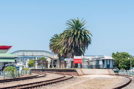 adjacent: KNYSNA, SOUTH AFRICA - MARCH 3, 2016: The historic station in Knysna is adjacent to the waterfront shopping and restaurant complex Editorial