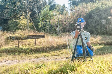 traffic officer: RHEENENDAL, SOUTH AFRICA - MARCH 4, 2016: A puppet traffic officer and fake radar camera next to the road to Millwood Editorial