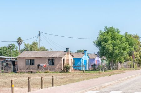 brilliantly: RHEENENDAL, SOUTH AFRICA - MARCH 4, 2016: Brilliantly colored houses at Rheenendal, a village on the Seven Passes Road in the Garden Route