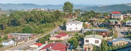town houses: KNYSNA, SOUTH AFRICA - MARCH 5, 2016: Panorama of Sunridge, a township in the northern part of Knysna, showing several houses Editorial