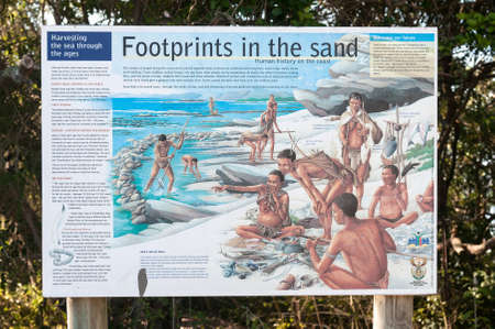 describing: KNYSNA, SOUTH AFRICA - MARCH 5, 2016: An information board at the beach in Noetsie, describing the history of humans on the coast of South Africa