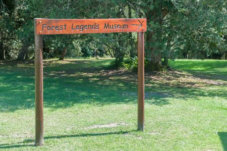 forestry industry: KNYSNA, SOUTH AFRICA - MARCH 5, 2016: A directional sign at Diepwalle for the Forest Legends Museum where the history of the forestry industry in the Knysna Forest is depicted