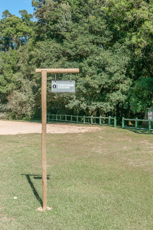 ceased: KNYSNA, SOUTH AFRICA - MARCH 5, 2016: Signpost where the historic Templeman Station stood at the Ysterhoutrug picnic spot in the Knysna Forest. The railway ceased operation in 1949 Editorial