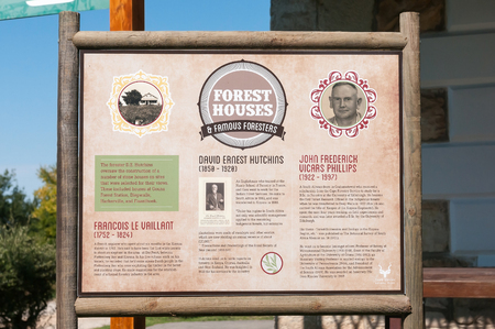 forestry industry: KNYSNA, SOUTH AFRICA - MARCH 5, 2016: An information board at Diepwalle on foresters who played a big role in the forestry industry in the Knysna Forest Editorial