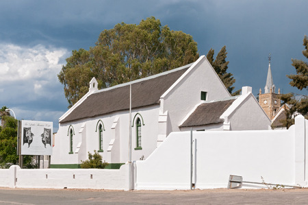 missionary: UNIONDALE, SOUTH AFRICA - MARCH 5, 2016: The Pinkster Protestant Church in Uniondale, originally built by the London Missionary Society circa 1843. The Little Theatre Cafe is behind the church