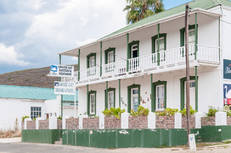 guesthouse: UNIONDALE, SOUTH AFRICA - MARCH 5, 2016: A storm brewing over a guesthouse an liquor store in Uniondale in the Western Cape Province Editorial