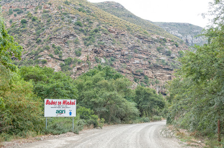 babes: BAVIAANSKLOOF, SOUTH AFRICA - MARCH 6, 2016: Signboard for a supermarket in the Baviaanskloof (baboon valley). There is no cell phone reception in the valley