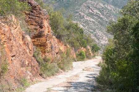 wilderness area: A steep section of the road in the Holgat Pass in the wilderness area of the Baviaanskloof (baboon valley) Stock Photo