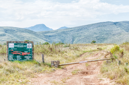 nature conservancy: BAVIAANSKLOOF, SOUTH AFRICA - MARCH 6, 2016: Information board and boom for the Bergplaas Hut in the Baviaanskloof (baboon valley). The board indicates distances and travel times from this point