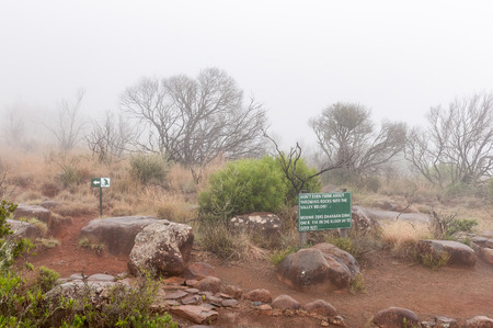desolation: A warning sign and route marker in thick fog on the Crag Lizard trail near the Valley of Desolation viewpoint