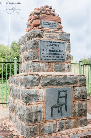 boer: MIDDELBURG, SOUTH AFRICA - MARCH 8, 2016: A monument for two Boer commanders in the Second Anglo-Boer War, who were executed, tied to a chair, by the British troops at this spot